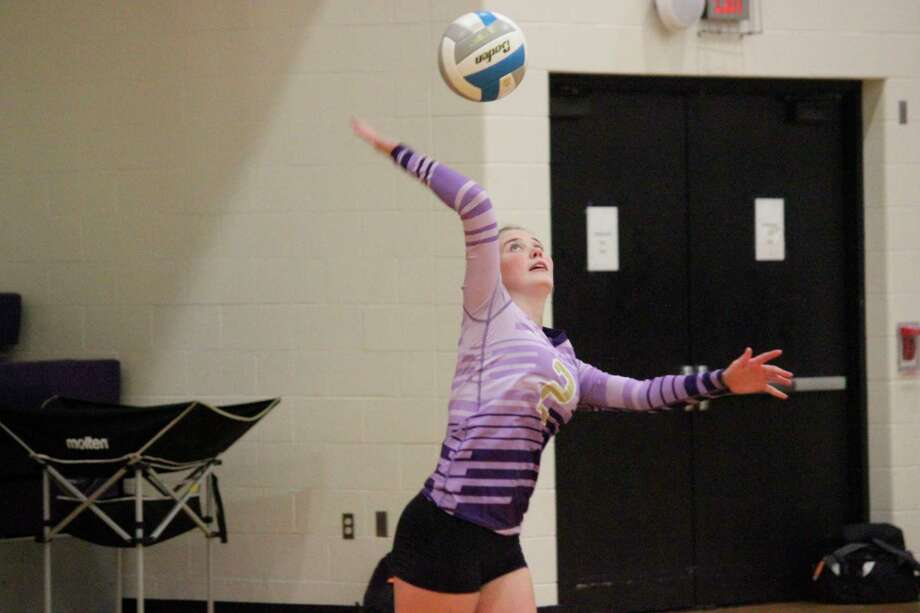 Maggie Kelly delivers a serve during Frankfort's home opener on Aug. 26. (File photo)