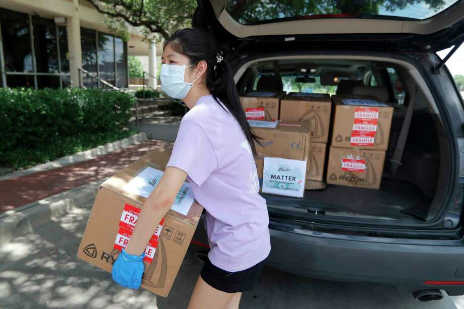 Valerie Xu, 15, delivers a donation, boxes of mask to UT Southwestern Medical Center in Dallas, Friday, June 5, 2020. Xu is among teens across the U.S. who decided to take action as the coronavirus pandemic took hold, doing everything from delivering groceries to older people to offering online tutoring, to emailing sick children and to raising money to help feed the hungry. (AP Photo/Tony Gutierrez) / Copyright 2020 The Associated Press. All rights reserved.