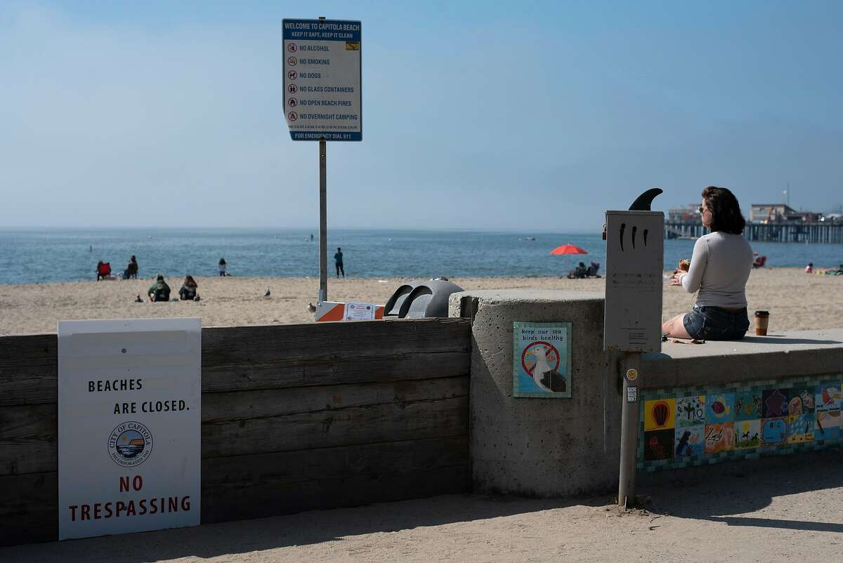 Despite signs stating beach closure, crowds gather at Capitola Beach as the weather heats up on Sept. 4, 2020.