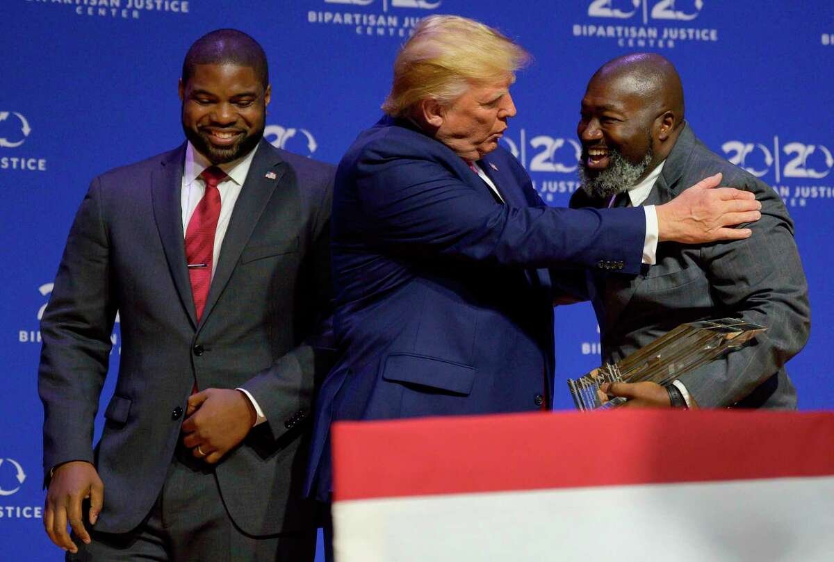 President Donald Trump is awarded the Bipartisan Justice Award from Matthew Charles, right, who was released from federal prison through the First Step Act. The First Step Act was an important achievement, but what comes next?