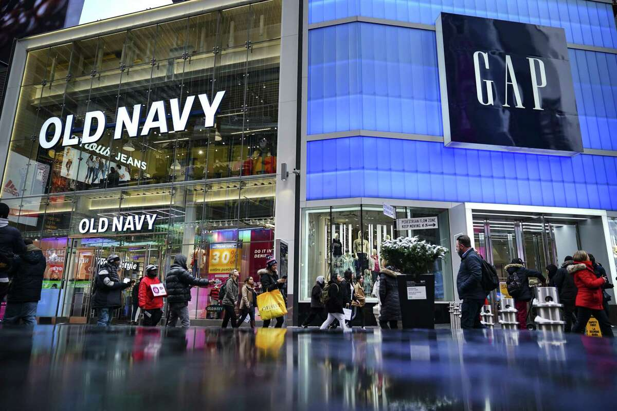 Old Navy, pictured here in 2019 in Times Square, has offered to pay its employees to serve as poll workers this election. That's the kind of public service the moment demands.