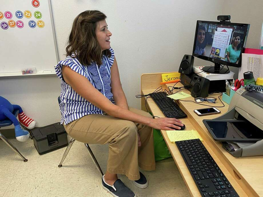 Lori Thompson, a Pre-K 3 teacher at Bingman Headstart in Beaumont ISD, gets ready for her virtual reading with students on first day of classes. Photo: Kim Brent / Beaumont Enterprise