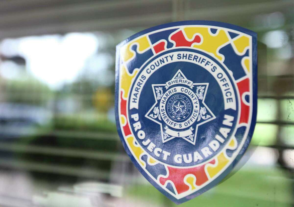 A Harris County Sheriff's Office Project Guardian sticker indicating a resident has autism is placed to be readily visible to deputies. Its design incorporates the autism-awareness puzzle piece.