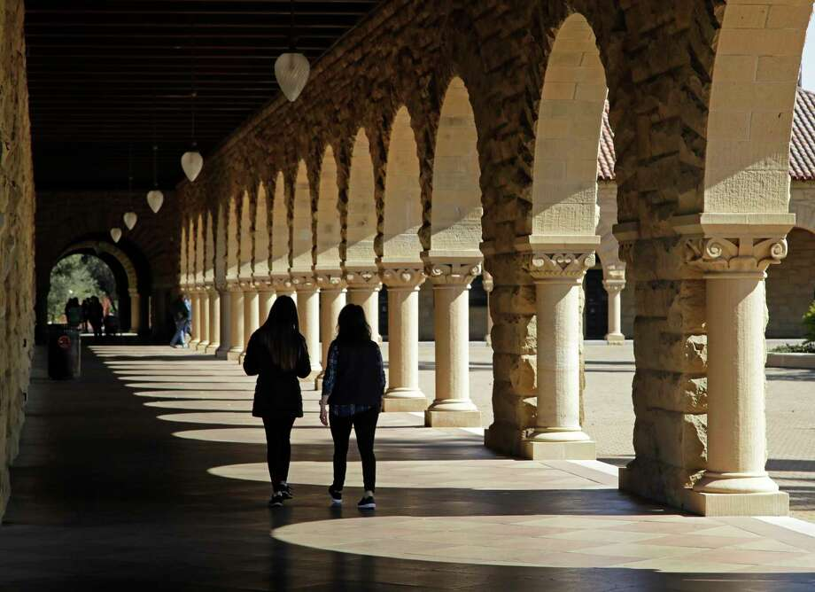 FILE - In this March 14, 2019, file photo students walk on the Stanford University campus in Santa Clara, Calif.  With what could be a slow economic recovery and loan debt on the rise, college students are looking for alternatives to pay for their education.  (AP Photo/Ben Margot, File) Photo: Ben Margot / Copyright 2019 The Associated Press. All rights reserved.