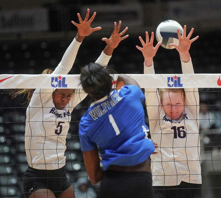 Plano West's Iman Ndiaye (1) spikes one over Ridge Point's Tiana Davis (5) and Claire jeter (16) during the Fort Bend Ridge Point High School vs. Plano West High School state semifinal volleyball match on Friday, November 22, 2019 at the Curtis Culwell Center in Garland, Texas. Plano West won 3 games to 2. CREDIT: Louis DeLuca for The Houston Chronicle Photo: Louis DeLuca / Copyright 2019 Louis DeLuca for the Houston Chronicle