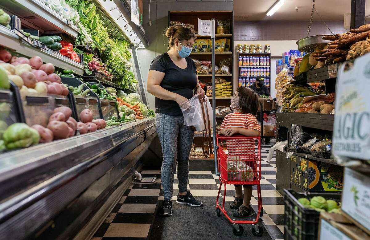 Nilsa Rodas shops with her son, Diego Rodas, at La Plaza Market on Friday, August 21, 2020, in the Canal neighborhood of San Rafael, Calif.