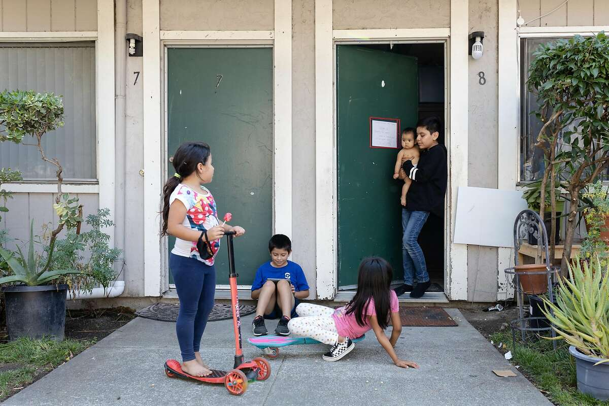 (Left to right) Nicol, Jayner, Jackie, Jailyne and Angel (no last names given) play outside their homes in the Canal neighborhood of San Rafael, Calif., on Friday, August 21, 2020.
