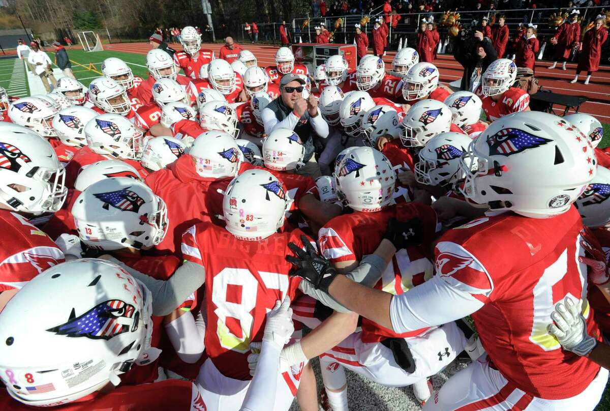 A Greenwich coach rallies his players before the start of the traditional Thanksgiving Day football game against Staples at Staples Stadium in Westport, Conn. on Nov. 28, 2019. Greenwich defeated Staples 38-14.