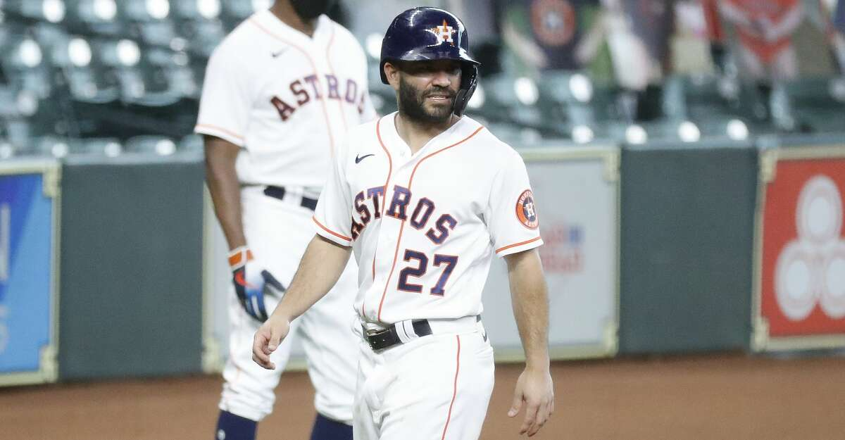 Houston Astros Jose Altuve (27) grimaces at third base after he slid into third as Yuli Gurriel lined out during the first inning of an MLB baseball game at Minute Maid Park, Thursday, September 3, 2020, in Houston.