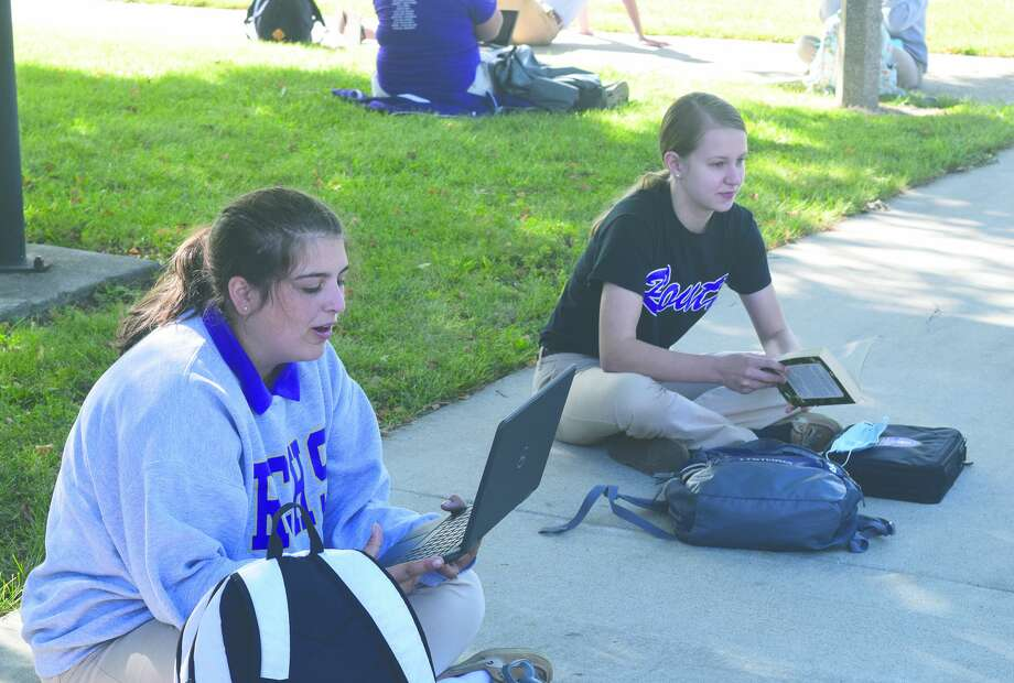 Routt freshmen Claire McGuire (left) and Amanda Laumakis attend study hall Friday outside Routt Catholic High School. Photo: Samantha McDaniel-Ogletree | Journal-Courier