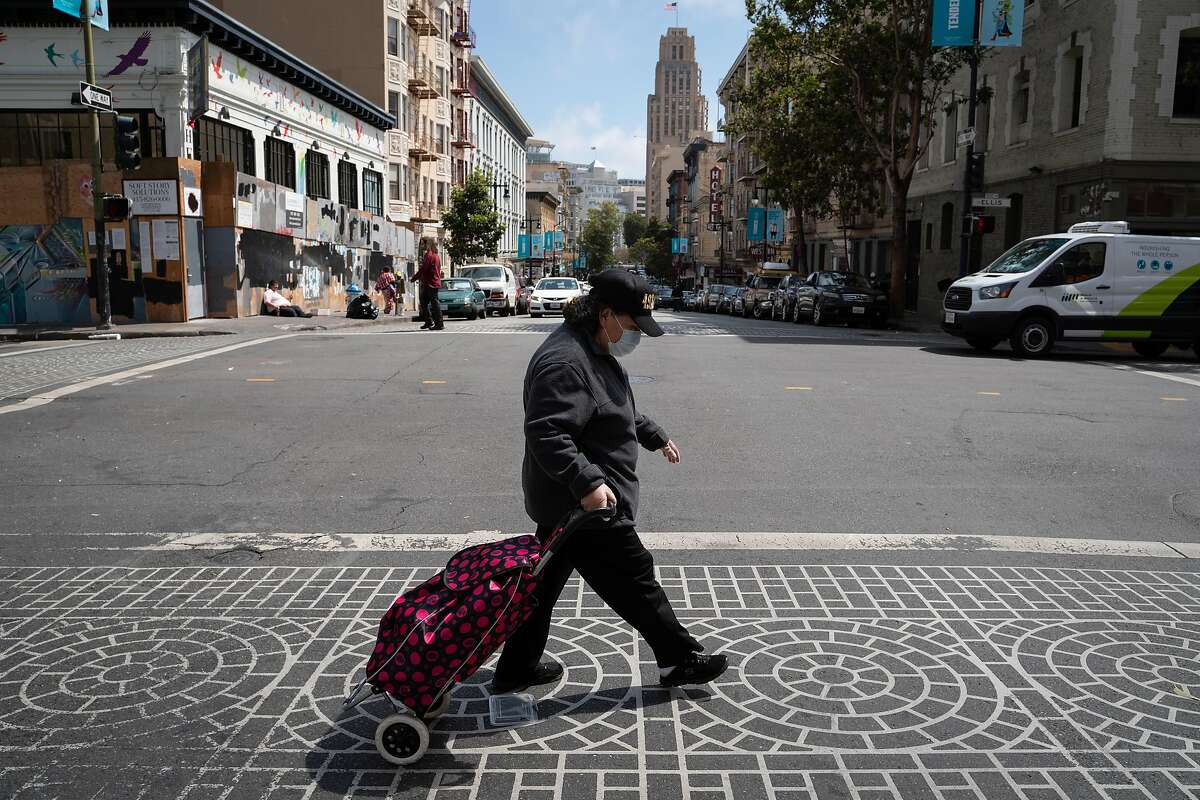 Rosa Alvarado, 58, walks up Ellis Street on her way to pick up a prescription from Walgreens in San Francisco, Calif., on Monday, August 10, 2020.