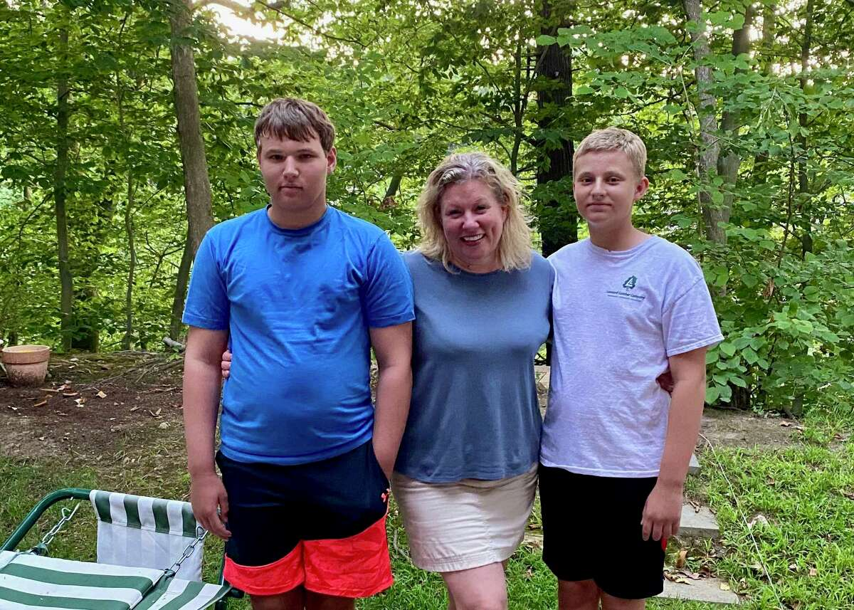 Tanya Leonard with her sons Noah, left, and Toby, right, of Greenwich. Toby will have in-class instruction every day, but Noah will have three days of remote learning.