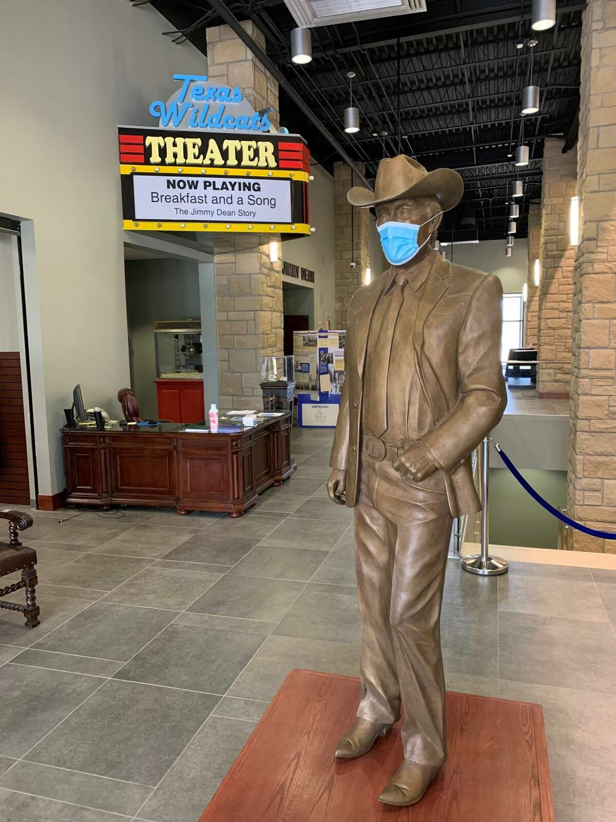 Jimmy Dean greets visitors with a mask.