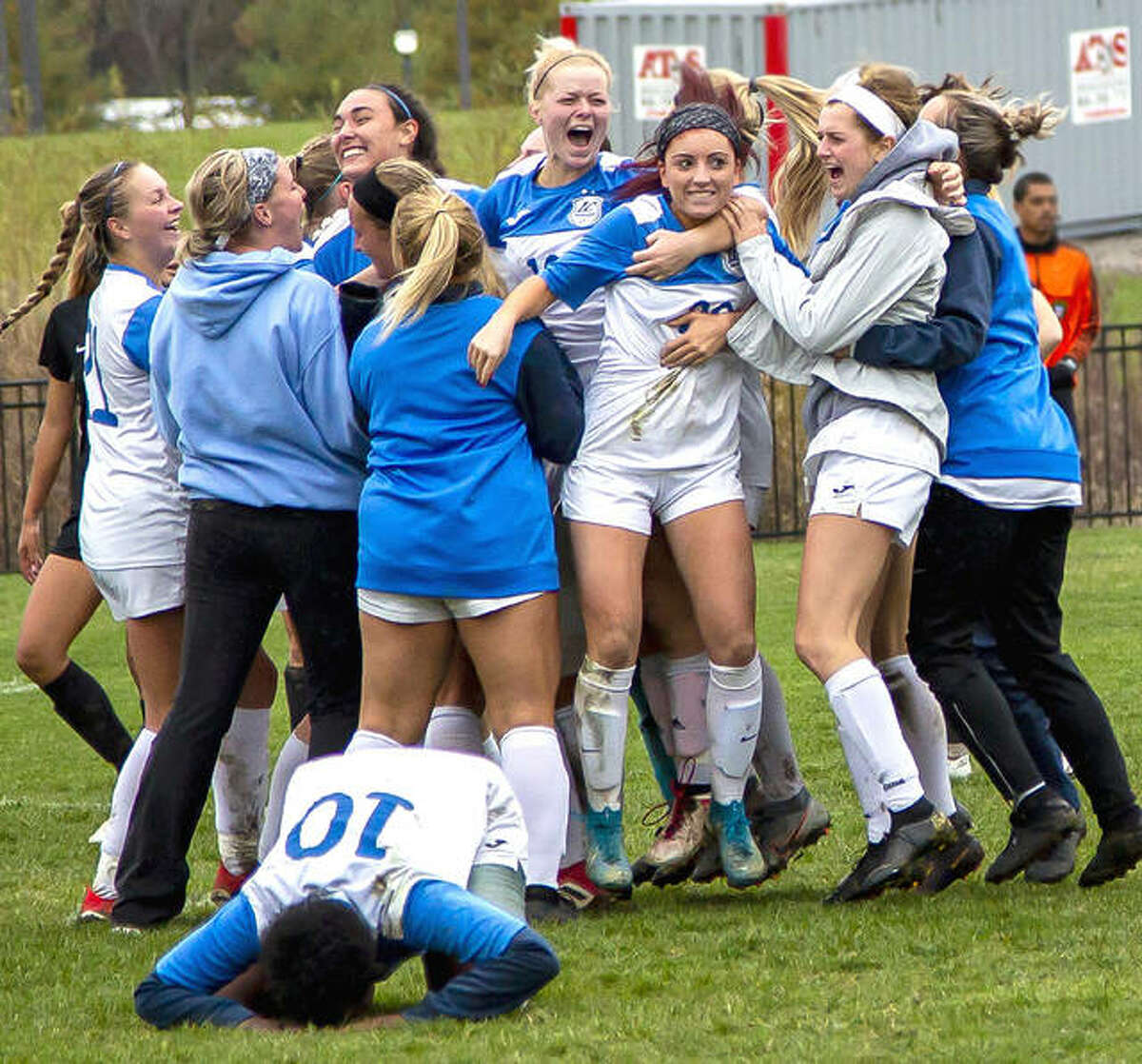 Members of the Lewis and Clark women's soccer team celebrate a playoff victory over rival Southwestern Illinois College last October in Godfrey. SWIC's soccer teams will move to NJCAA Division II when play resumes in the spring, meaning the end, for now, of the intense postseason rivalry with LCCC.