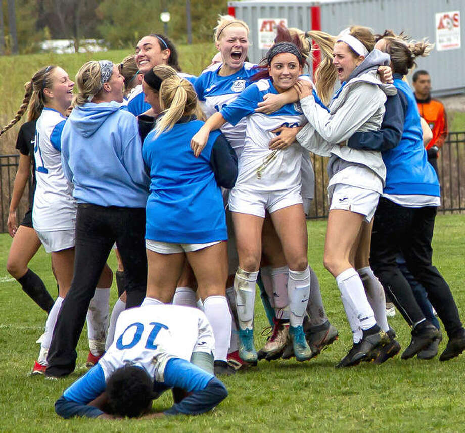 Members of the Lewis and Clark women's soccer team celebrate a playoff victory over rival Southwestern Illinois College last October in Godfrey. SWIC's soccer teams will move to NJCAA Division II when play resumes in the spring, meaning the end, for now, of the intense postseason rivalry with LCCC. Photo: Jan Dona | For The Telegraph