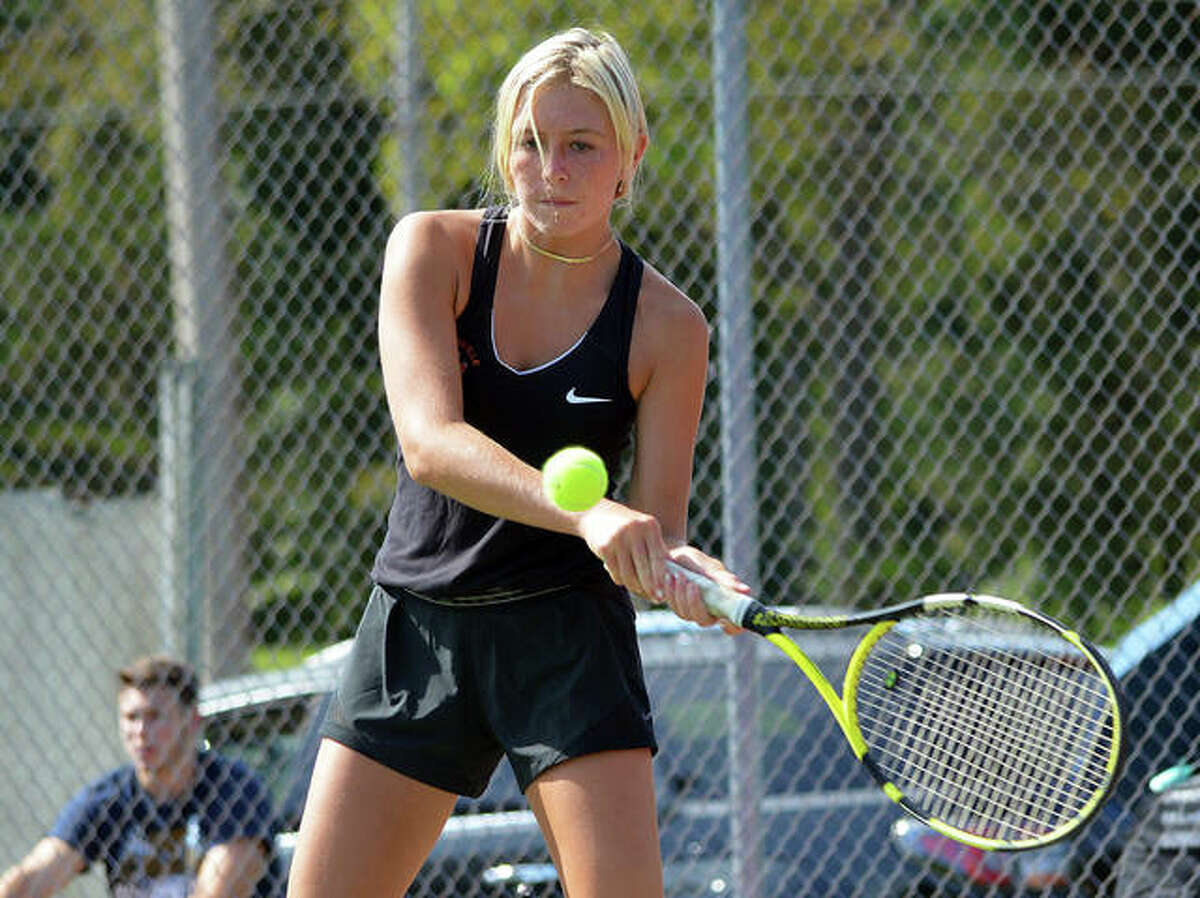 Edwardsville's Emma Herman makes a forehand return during her No. 5 singles match against Althoff on Friday in the opening round of the Heather Bradshaw Memorial Invitational.