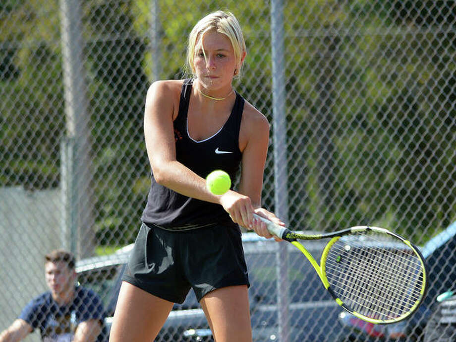 Edwardsville's Emma Herman makes a forehand return during her No. 5 singles match against Althoff on Friday in the opening round of the Heather Bradshaw Memorial Invitational. Photo: Scott Marion/The Intelligencer
