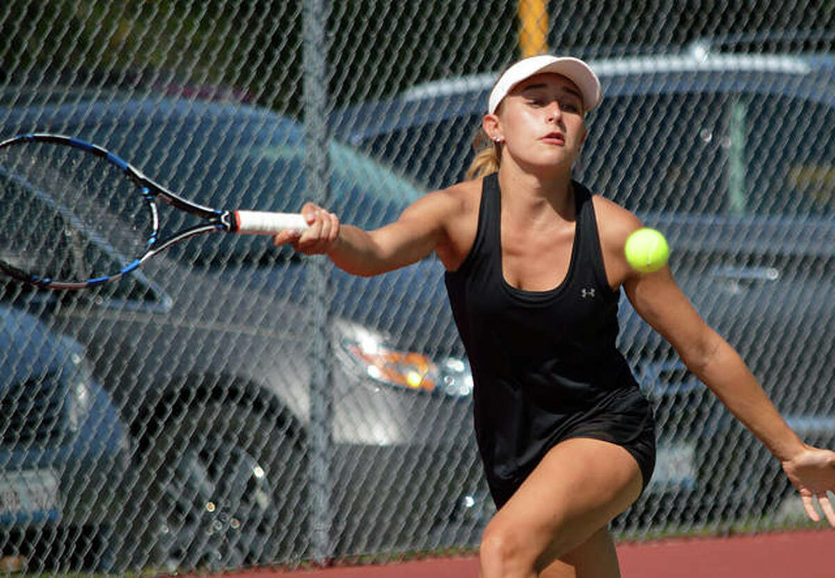 Edwardsville's Grace Hackett reaches for a shot during her No. 4 singles match against Althoff on Friday in the opening round of the Heather Bradshaw Memorial Invitational.