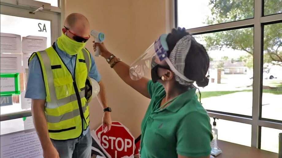 Fort Bend ISD officials have been busy developing a new set of health and satety protocols to protect against the speread of COVID-19> In a video recently posted by district officials, a district employee undergoes contactless temperature check. Photo: FBISD Image