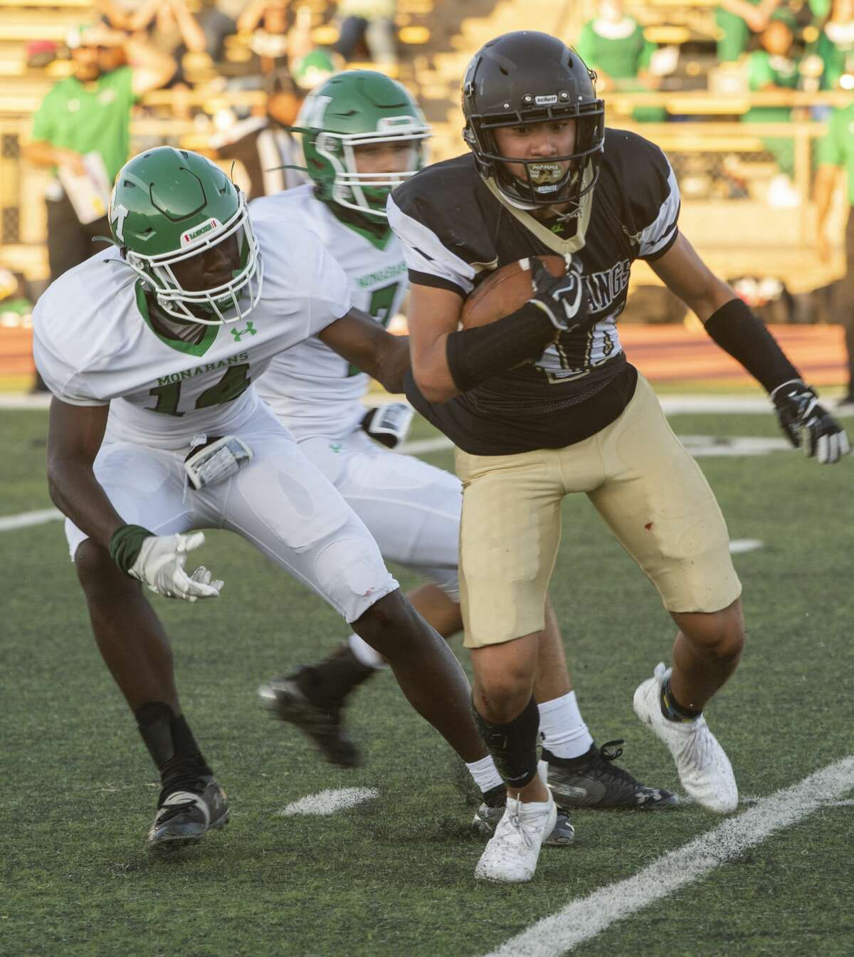 Andrews' Anthony Trevino looks for more yards as he gets away from Monahans' Leonard Davis 09/04/2020 at the Andrews Mustang Bowl. Tim Fischer/Reporter-Telegram