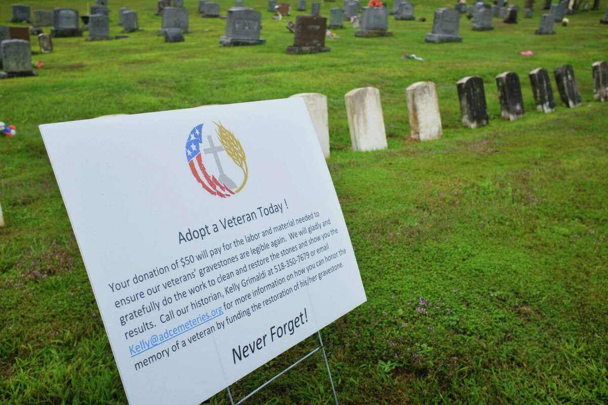 A view of an informational sign at St. Mary's Cemetery on Wednesday, Sept. 2, 2020, in Troy, N.Y. Albany Diocesan Cemeteries Historian Kelly Grimaldi is heading up a project to get veteran's headstones cleaned up. (Paul Buckowski/Times Union)