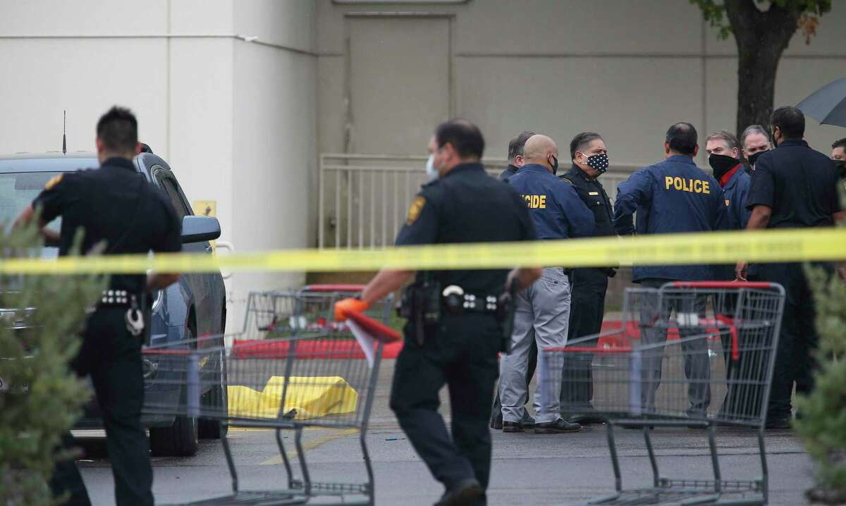 A person lies dead in the parking of an H-E-B store on Fredericksburg Road, Friday, Sept. 4 2020.