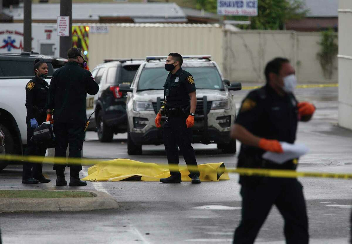 A shoplifting suspect lies dead in the parking lot of the H-E-B in the city's Deco District at 2118 Fredericksburg Road. The wounded police officer was taken to SAMMC.