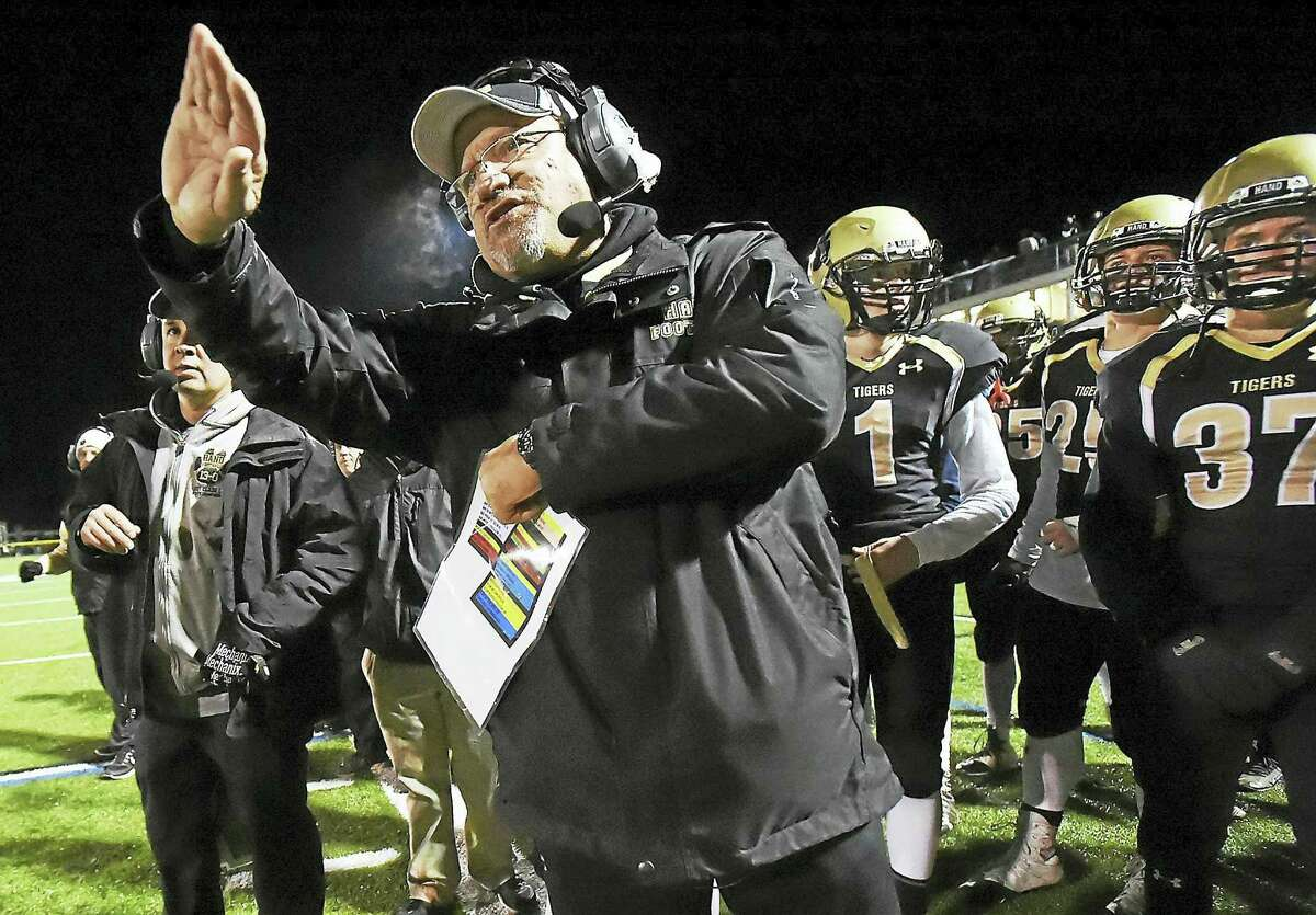 Hand's Steve Filippone coaches the Tigers to a 44-0 win over Guilford, Wednesday, on the eve of Thanksgiving and Filippone's final game of his career, November 23, 2016, at Strong Field at the SurfClub in Madison. (Catherine Avalone/New Haven Register)