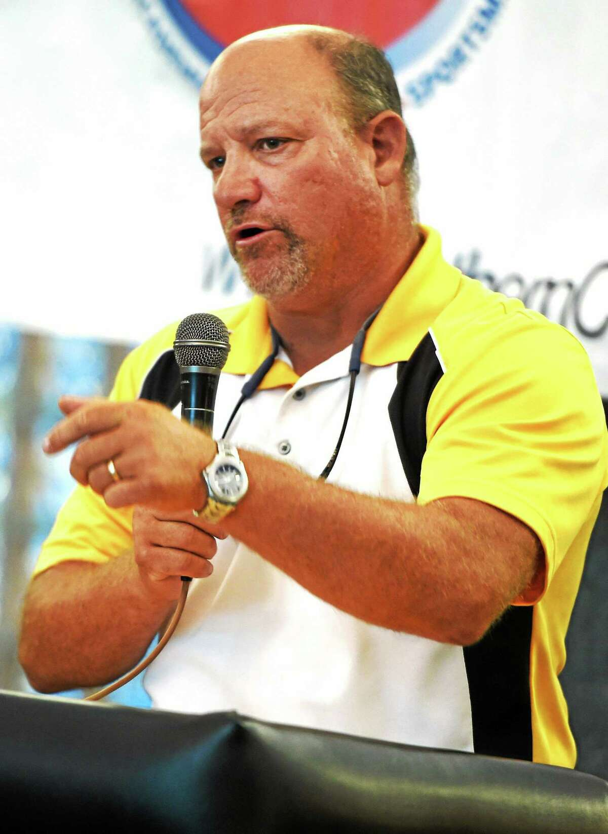 (Peter Hvizdak - New Haven Register) ¬ Daniel Hand H.S> football coach Steve Filippone speaks about his team and the league during SCC Football Media NIght at the Floyd Little Athletic Center in New Haven Sunday, August 24, 2014. ¬