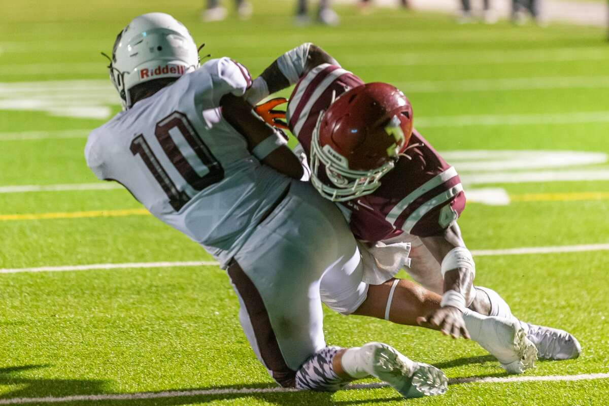 Silsbee's Quincy Kelly, Jr. (10) gets past Jasper's Andre Thomas (4) for the Tigers' first score of the game in the second quarter. The Jasper Bulldogs opened their football season with the opener against the Silsbee Tigers in Jasper on Friday night. Photo made on September 4, 2020. Fran Ruchalski/The Enterprise