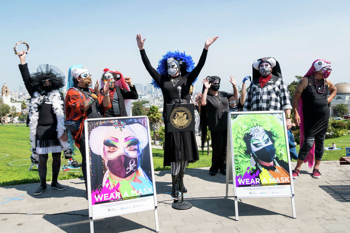 Sister Roma and the Sisters of Perpetual Indulgence cheer after speaking at the press conference at Dolores Park. They were there to hand out one thousand face masks.