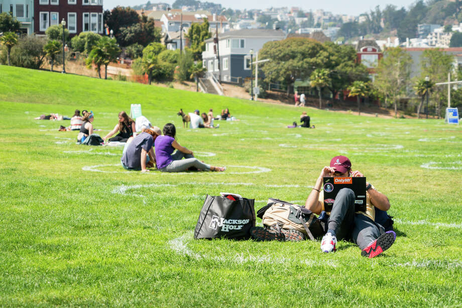 People enjoy the warm weather in socially distanced circles at Dolores Park in San Francisco, California on Sept. 4, 2020. Photo: Patricia Chang/Special To The SFGATE / Special to the SFGATE