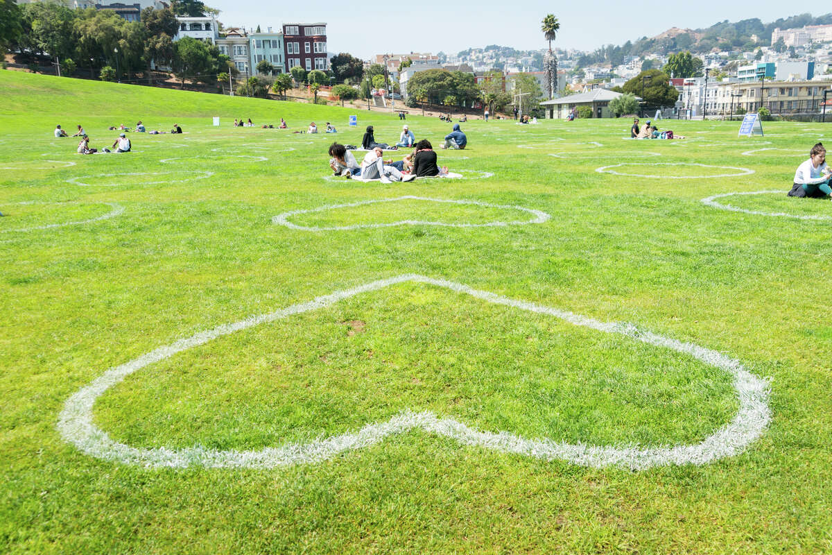 People enjoy the warm weather in socially distanced circles at Dolores Park in San Francisco, Calif., on Sept. 4, 2020.