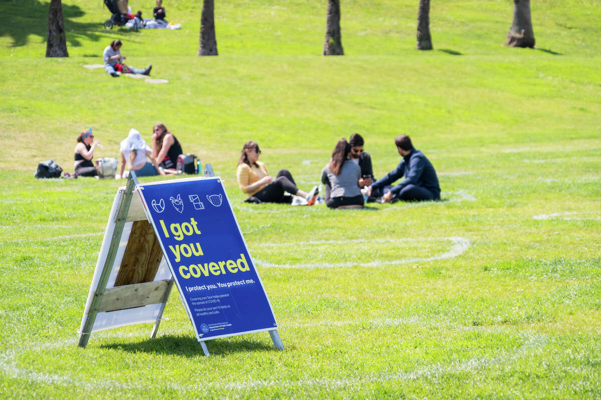 People enjoy the warm weather in socially distanced circles at Dolores Park in San Francisco, California on Sept. 4, 2020.