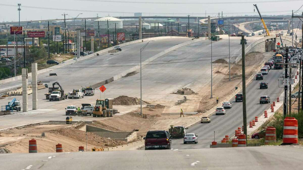 Traffic moves south on Sept. 3 along U.S. 281 toward Evans Road next to construction of the expanded lanes of the highway.