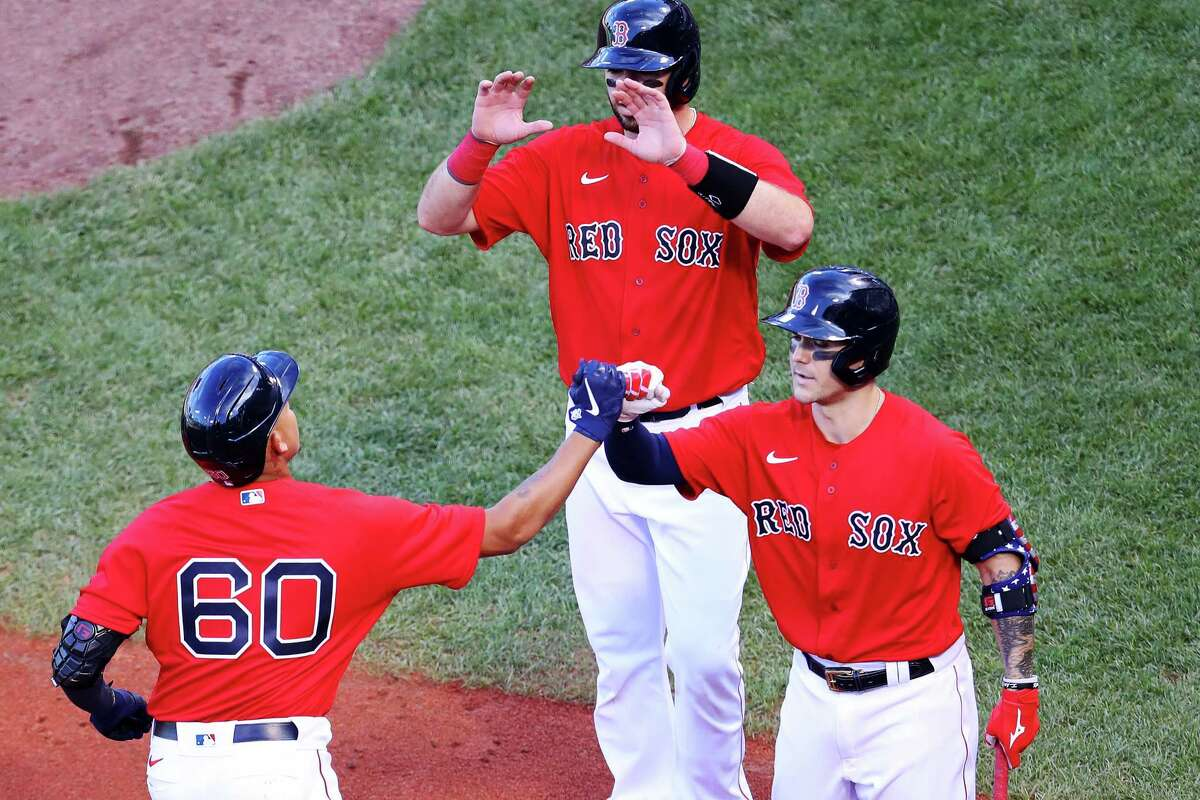 BOSTON, MASSACHUSETTS - SEPTEMBER 04: Yairo Munoz #60 of the Boston Red Sox celebrates with Michael Chavis #23 after hitting a home run against the Toronto Blue Jays during the fourth inning at Fenway Park on September 04, 2020 in Boston, Massachusetts. (Photo by Maddie Meyer/Getty Images)