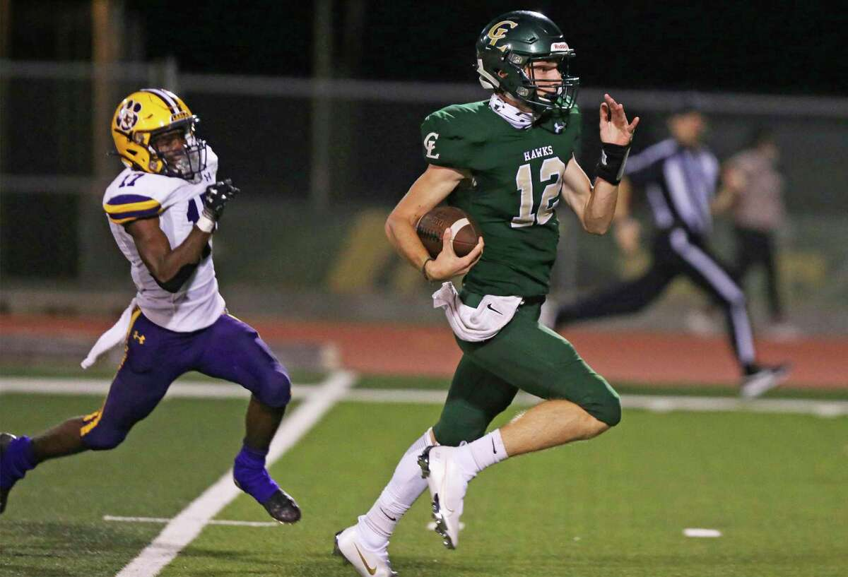 Peyton McMUllen takes the ball for a long gain in the second quarter for the Hawks as Canyon Lake hosts La Grange at Canyon Lake High School stadium on Sept. 4, 2020.