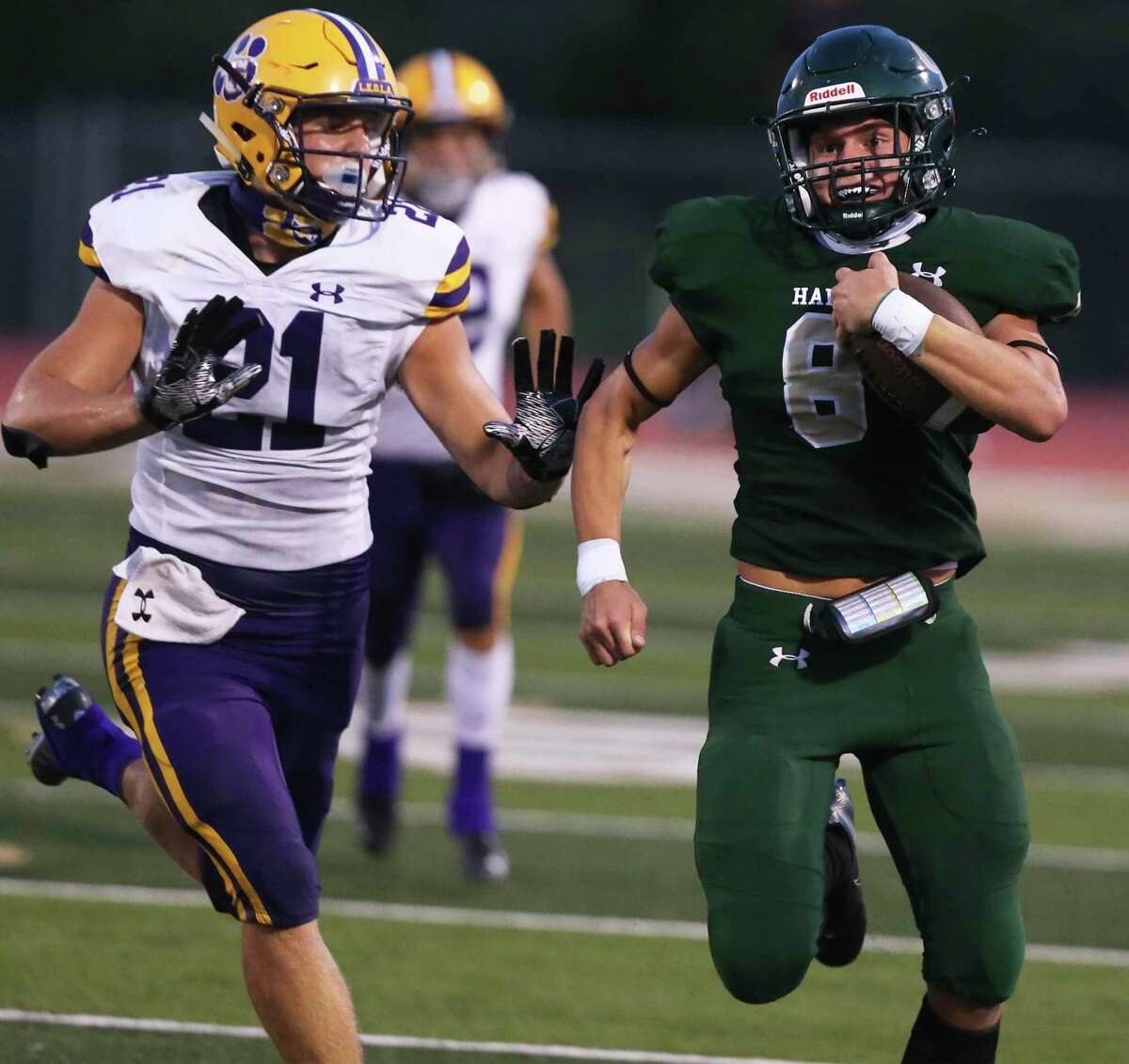 Jesse Horner clears down the sideline on a run for the Hawks as Canyon Lake hosts La Grange at Canyon Lake High School stadium on Sept. 4, 2020.