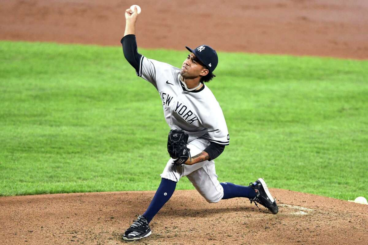 BALTIMORE, MD - SEPTEMBER 04: Deivi GarcA-a #83 of the New York Yankees pitches in the third inning during game two of a doubleheader baseball game against the Baltimore Orioles at Oriole Park at Camden Yards on September 4, 2020 in Baltimore, Maryland. (Photo by Mitchell Layton/Getty Images)