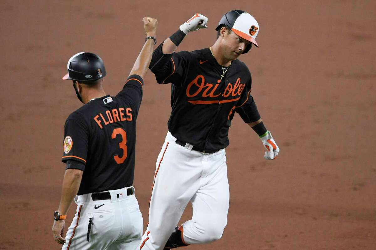 Baltimore Orioles' Ryan Mountcastle celebrates his two-run home run with third base coach Jose Flores (3) during the second inning of the second baseball game of a doubleheader against the New York Yankees, Friday, Sept. 4, 2020, in Baltimore. It is a makeup of a game that was postponed on Aug. 5. (AP Photo/Nick Wass)