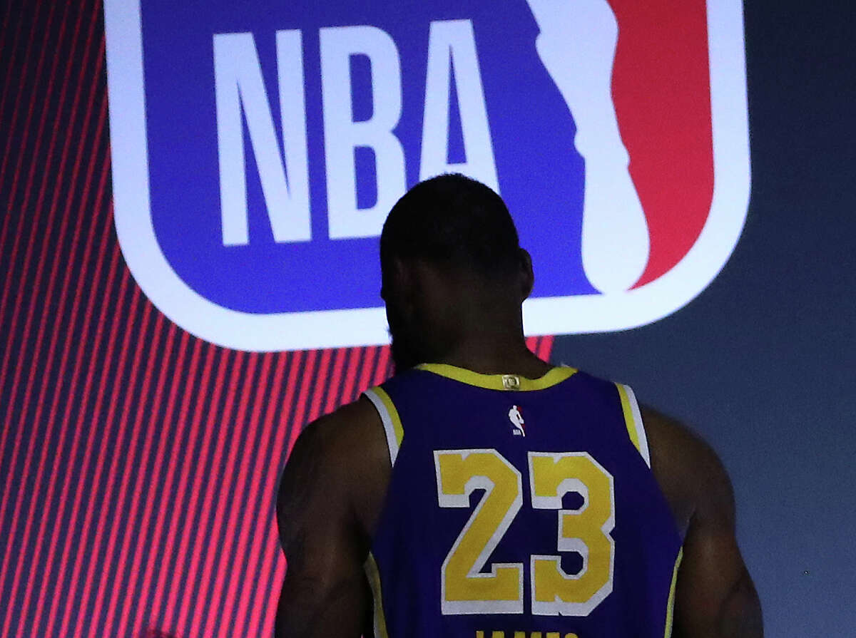 LAKE BUENA VISTA, FLORIDA - SEPTEMBER 04: LeBron James #23 of the Los Angeles Lakers exits the court after their loss to Houston Rockets in Game One of the Western Conference Second Round during the 2020 NBA Playoffs at AdventHealth Arena at the ESPN Wide World Of Sports Complex on September 04, 2020 in Lake Buena Vista, Florida. NOTE TO USER: User expressly acknowledges and agrees that, by downloading and or using this photograph, User is consenting to the terms and conditions of the Getty Images License Agreement. (Photo by Mike Ehrmann/Getty Images)