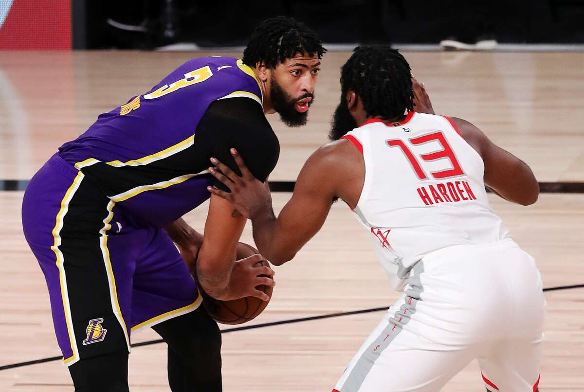 LAKE BUENA VISTA, FLORIDA - SEPTEMBER 04: Anthony Davis #3 of the Los Angeles Lakers drives the ball against James Harden #13 of the Houston Rockets during the fourth quarter in Game One of the Western Conference Second Round during the 2020 NBA Playoffs at AdventHealth Arena at the ESPN Wide World Of Sports Complex on September 04, 2020 in Lake Buena Vista, Florida. NOTE TO USER: User expressly acknowledges and agrees that, by downloading and or using this photograph, User is consenting to the terms and conditions of the Getty Images License Agreement. (Photo by Mike Ehrmann/Getty Images)