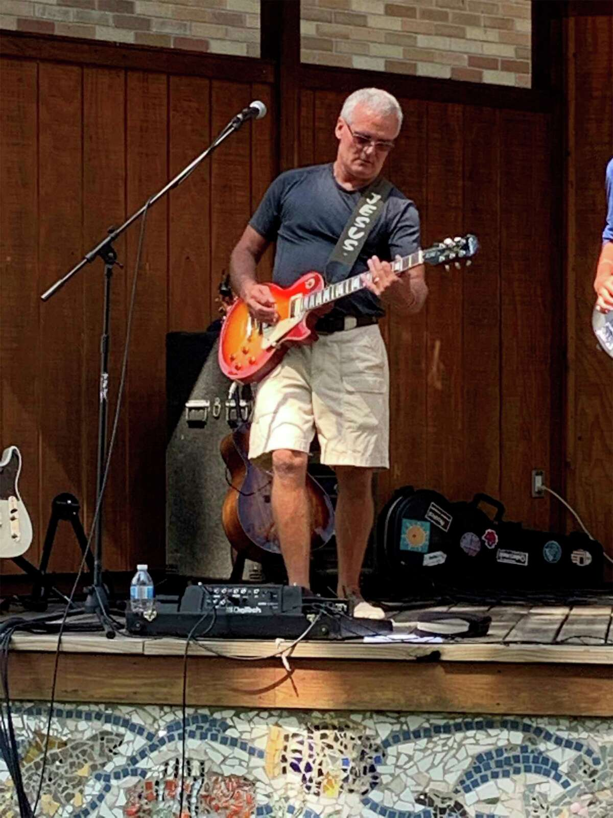 Dave Yonker, of the DaveYonkerBand, plays a solo during a concertAug. 23 at Brooks Park in Newaygo. (Pioneer photo/Julie Norwood)