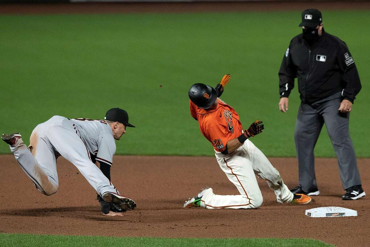 SAN FRANCISCO, CA - SEPTEMBER 04: Mauricio Dubon #1 of the San Francisco Giants is tagged out at second base by Nick Ahmed #13 of the Arizona Diamondbacks during the eighth inning at Oracle Park on September 4, 2020 in San Francisco, California. The Arizona Diamondbacks defeated the San Francisco Giants 6-5. (Photo by Jason O. Watson/Getty Images)