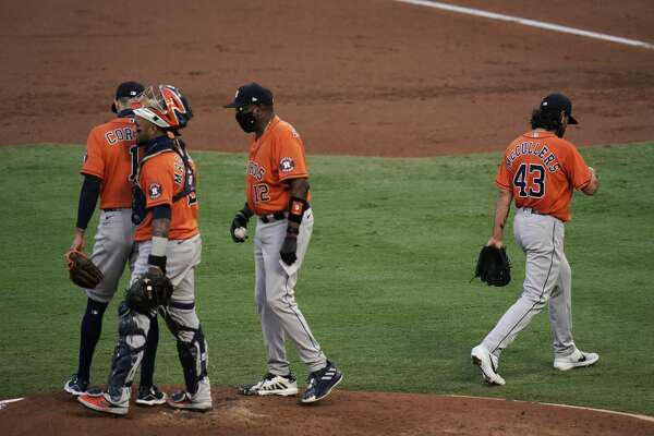 Houston Astros starting pitcher Lance McCullers Jr., right, leaves the mound after he was removed by manager Dusty Baker, second from right, during the first inning of the team's baseball game against the Los Angeles Angels, Friday, Sept. 4, 2020, in Anaheim, Calif. (AP Photo/Jae C. Hong)