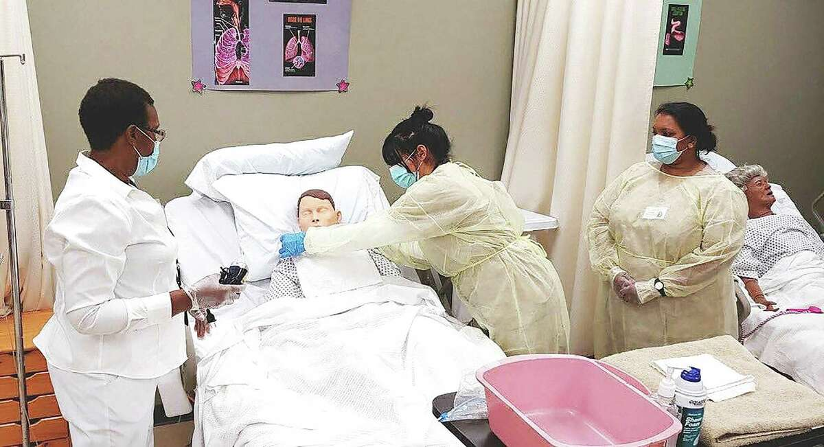 Lone Star College nursing students work together during training in the simulated rooms. The college is now offering a bachelor's degree in nursing.
