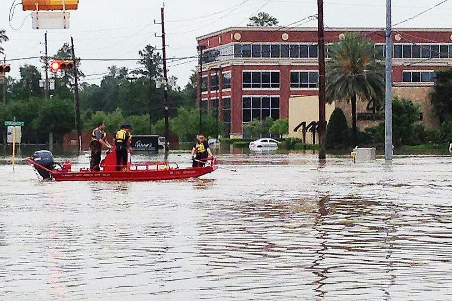A search and rescue mission underway during the historic Harvey flooding in front of an office building on Cypresswood Drive where Congressman Crenshaw now has an office. Photo: Submitted