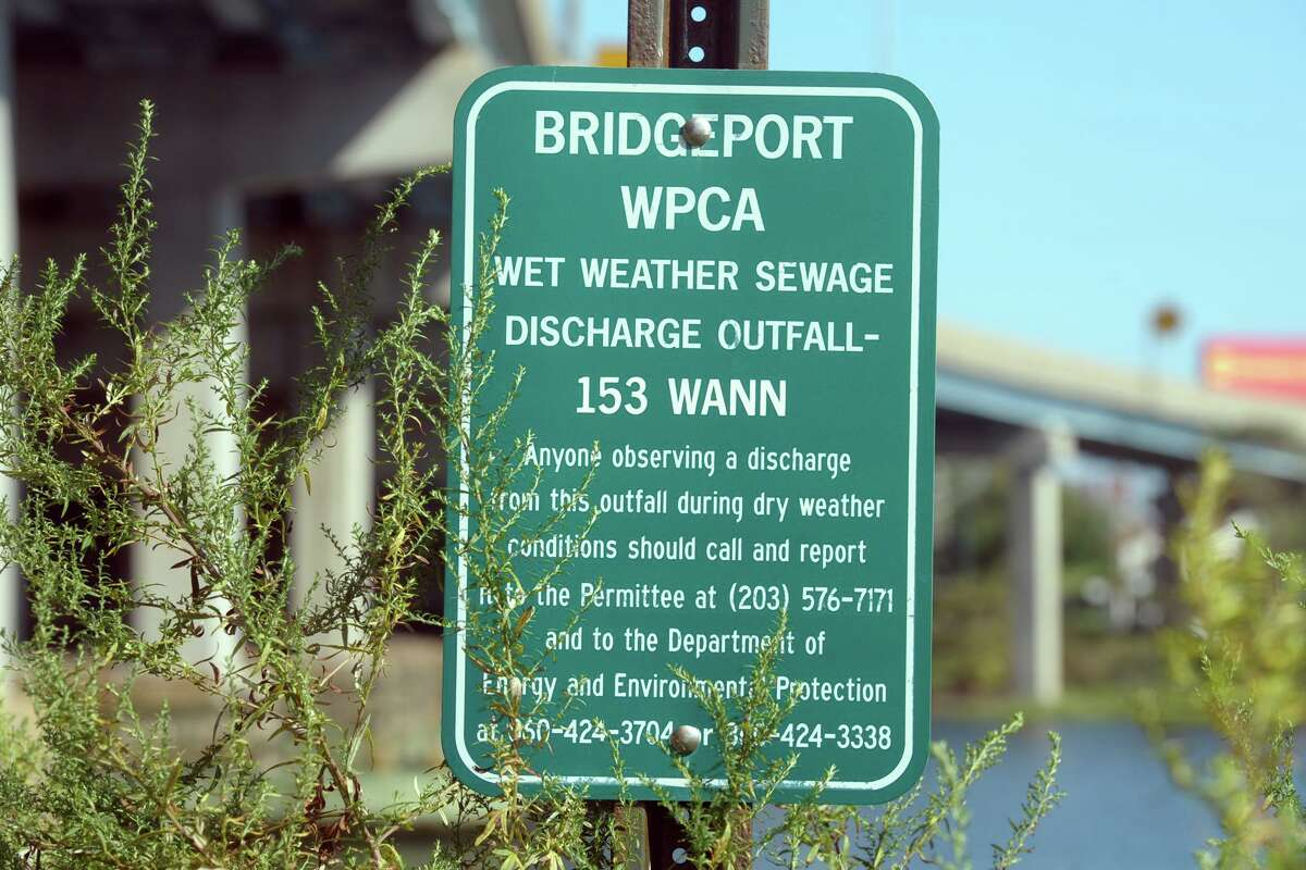 Signage marking a Combined Sewer Overflow location along Waterview Ave., adjacent to Yellow Mill Creek in Bridgeport on Friday.