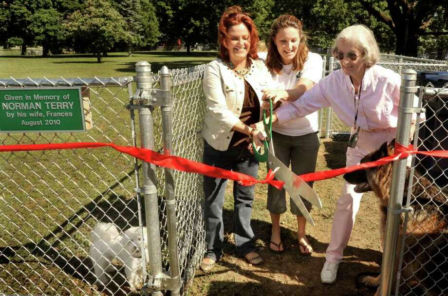 Tammy Reardon, left, Lori Sartwell, center, and Frances Terry, cut the ribbon at the opening the New Milford Dog Park, Saturday, Aug. 28, 2010. Photo: Michael Duffy / The News-Times