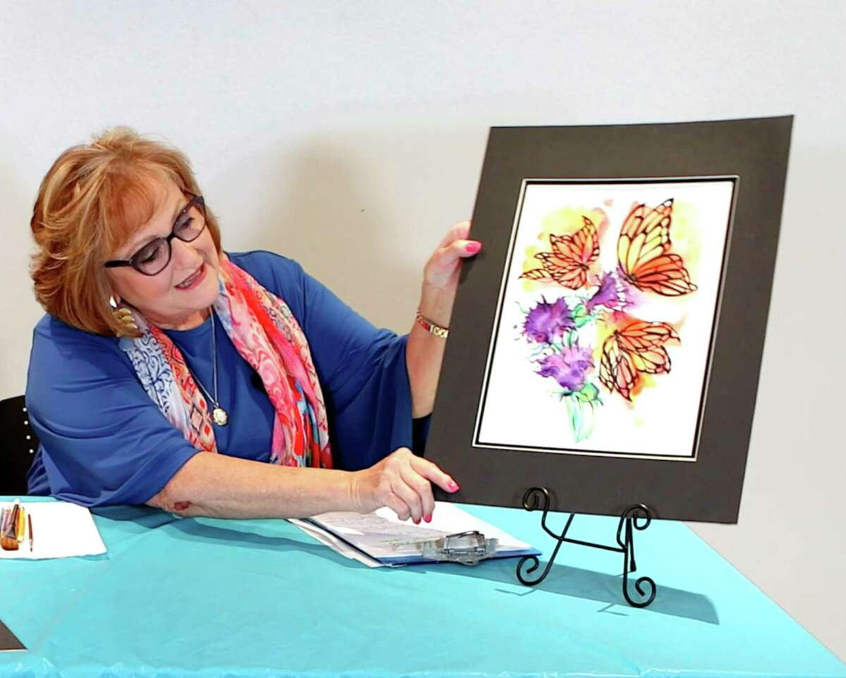 Pearl Fincher Museum of Fine Art virtual art class instructor Evelyn Bouley holds a copy of Monarch Butterfly. Director of Development Clara Lewis said they've had to reinvent themselves since first closing, March 17, amid the COVID-19 pandemic and reopening three months later, June 16.
